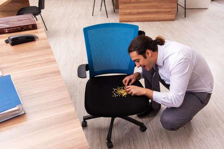 Ofice prank with sharp thumbtacks on chair