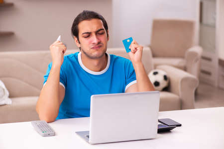 Sport bet addicted young man betting at home