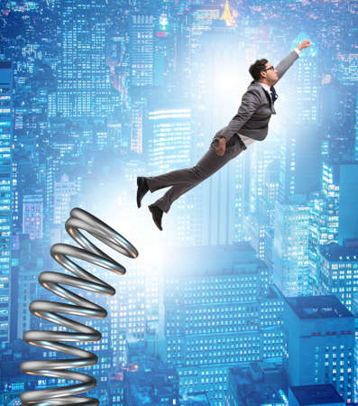 Businessman jumping from spring in promotion concept Foto de archivo