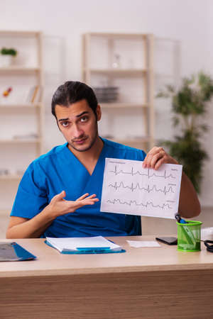 Young male doctor cardiologist working in the clinic