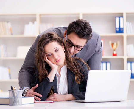Sexual harassment concept with man and woman in office Imagens