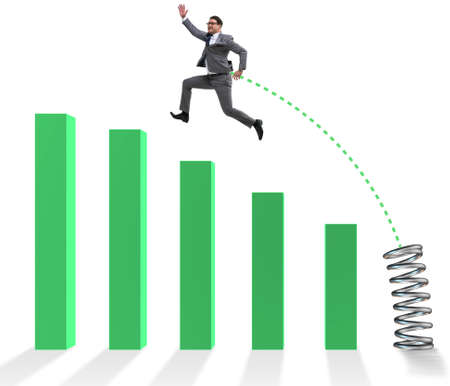 Business people jumping over bar charts Foto de archivo