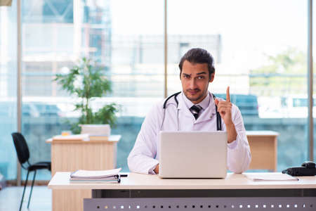 Young male medic working in the clinic Stock Photo