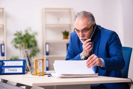 Old male employee businessman in time management concept