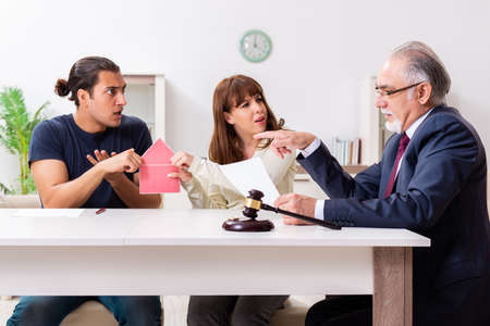 Lawyer talking to divorcing couple at home