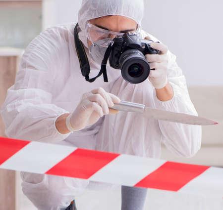 Forensic expert at crime scene doing investigation Archivio Fotografico