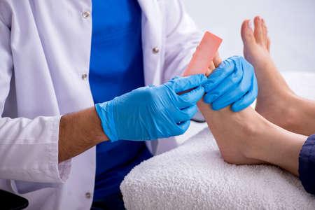 Podiatrist treating feet during procedure Stock Photo
