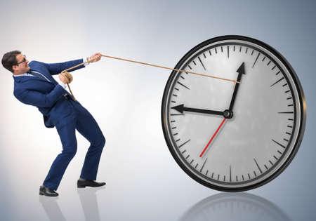 Businessman in time management concept Imagens