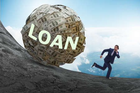 Businessman running away in debt and loan concept Stock Photo
