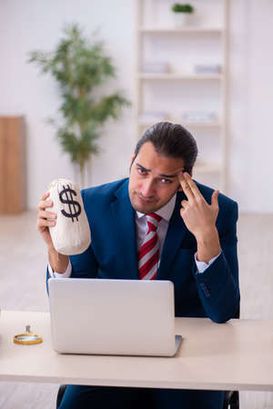 Young businessman employee in remuneration concept