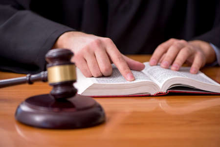 Young male judge working in the courtroom Stockfoto