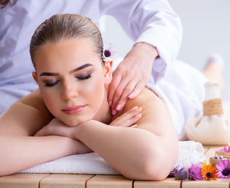 Woman during massage session in spa Stock fotó