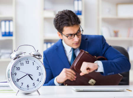Businessman in bad time management concept