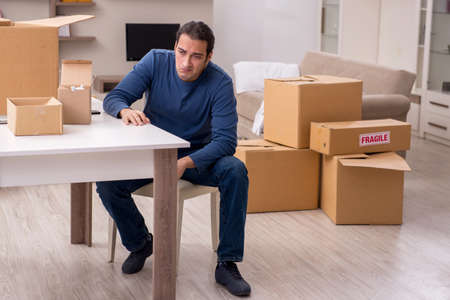 Young man moving to new flat