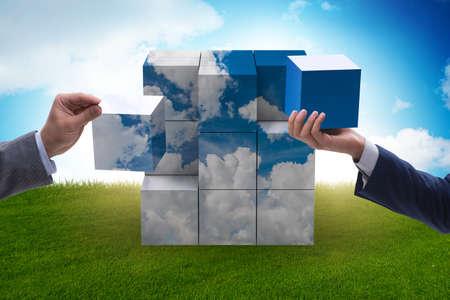 Businessman building cloud cube with shapes Foto de archivo