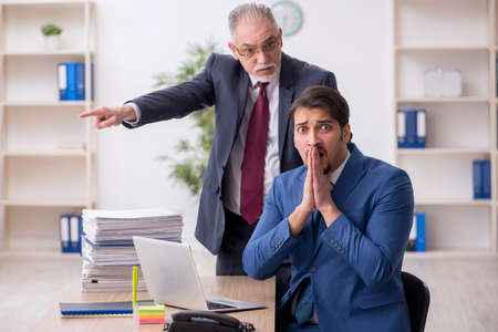 Two male employees in unemployment concept