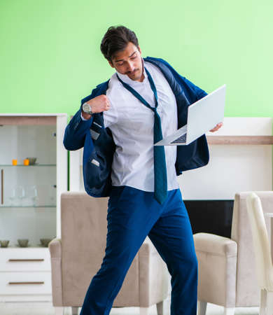 Man dressing up and late for work