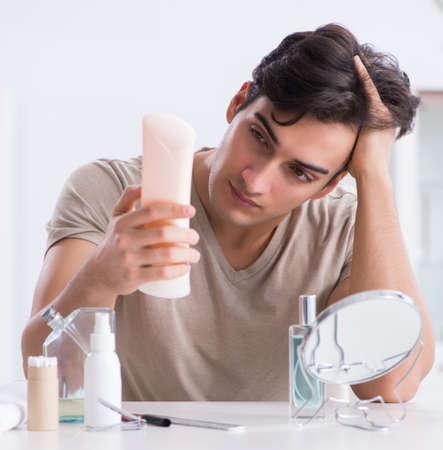 Young handsome man staring in the mirror Stock Photo