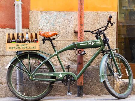 Retro military bike against the wall