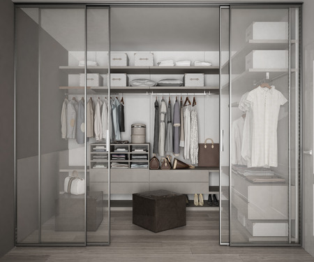 Classic walk in closet with glass sliding doors