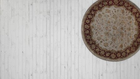 Vintage background with white wooden floor and classic round carpet 스톡 콘텐츠