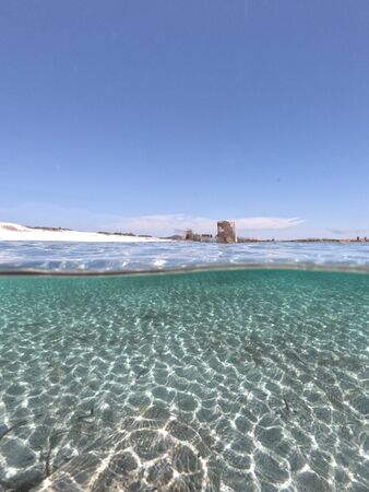Amazing blue sea with white sand underwater in Sardinia, Stintino, panorama background, ripple water surface with copy space