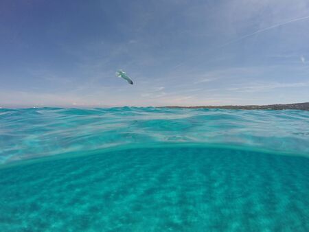 Amazing blue sea with white sand underwater in Sardinia, Stintino, seagulls, panorama background, ripple water surface with copy space Stock Photo