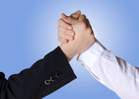 competitiveness: two business hands in rivalry or teamwork gesture Stock Photo
