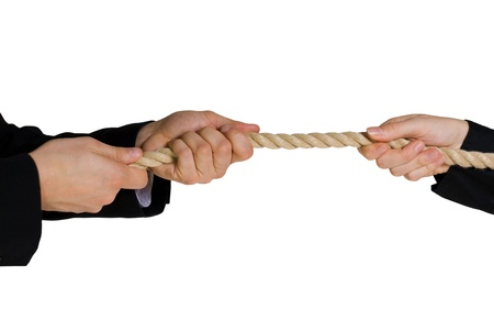 rivalry: some business hands doing tug of war symbolizing rivalry in business sectors