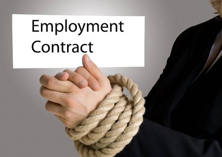 businesswoman with hands in chain hold a banner on which is written employment contract