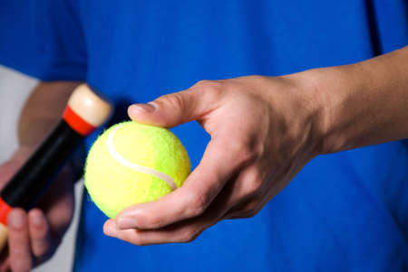 hands holding tennis ball and racket as cutout Stock Photo - 16077891