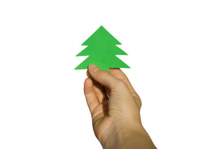 hand holds a green banner in form of a christmas tree on white photo