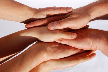 many hands symbolizing teamwork photo