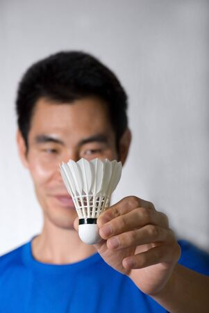 asian man holds a shuttlecock in his hands Stock Photo - 16239271