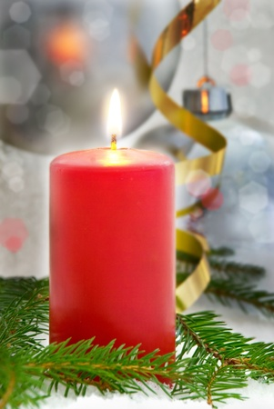 one red single shining candle as dark christmas or advent seasonal background photo