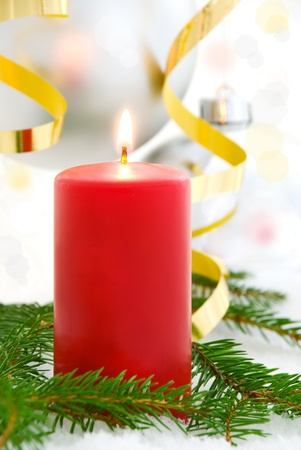 christmas atmosphere: one single red candle shining; advent and christmas seasonal background