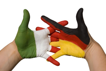 flag germany: one hand with german flag and one hand with italian flag shake hands