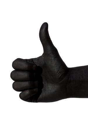 positiv: a black painted hand is doing a thumbs up gesture, on white