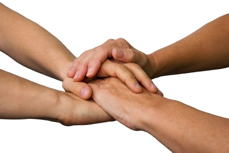 four hands symbolizing success, power, teamwork and strength, on white photo