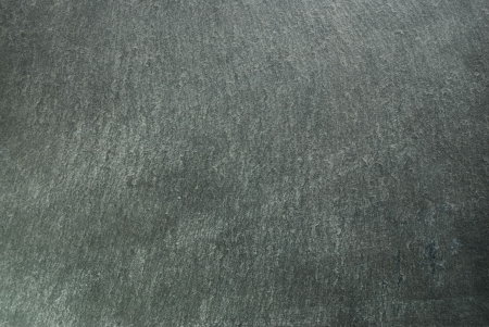 Shale: a slate or shale as backgorund or texture, grey