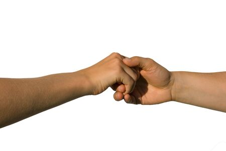 parship: a careful handshake between two young hands, isolated on white Stock Photo