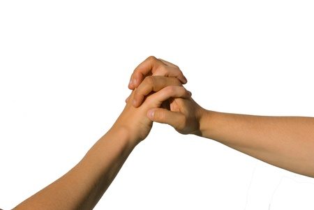 parship: two young hands holding each other, symbolizing support, help, unity and relationship Stock Photo