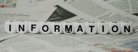 sixth form: la palabra informaci�n acostado sobre un fondo peri�dico Foto de archivo