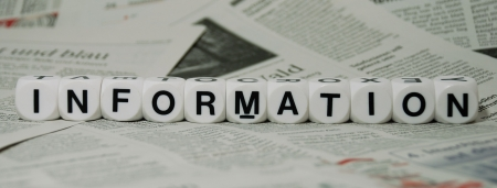 the word information lying on a newspaper background Stock Photo - 17324906