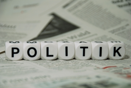 evening newspaper: the word politik on newspaper background Stock Photo