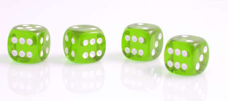 four green dice showing number six, on white Stock Photo - 17314745