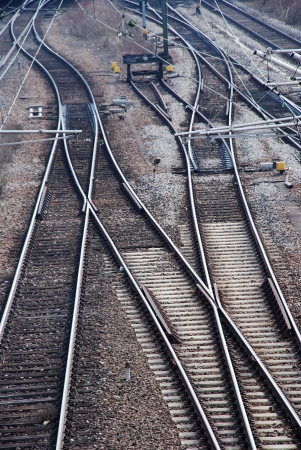many railway tracks leading to different ways photo