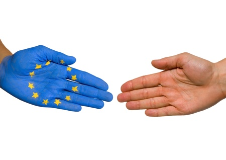 a handshake between two hands, one painted with the european flag Stock Photo - 17368899