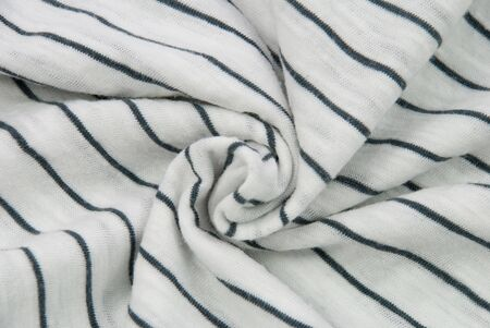 synthetic fiber: white cloth background with blue stripes, disarranged Stock Photo