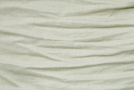 synthetic fiber: beige structure background of creases Stock Photo